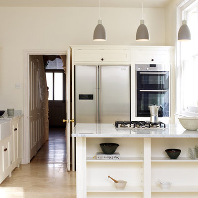 Example of a trendy kitchen design in London with a peninsula