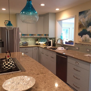 Mid-sized eclectic u-shaped kitchen pantry in Atlanta with an undermount sink, flat-panel cabinets, turquoise cabinets, granite benchtops, grey splashback, glass tile splashback, stainless steel appliances, medium hardwood floors and with island.