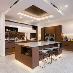 Design ideas for a contemporary kitchen in Melbourne with a single-bowl sink, flat-panel cabinets, dark wood cabinets, white splashback, stainless steel appliances, with island, grey floor and grey benchtop.