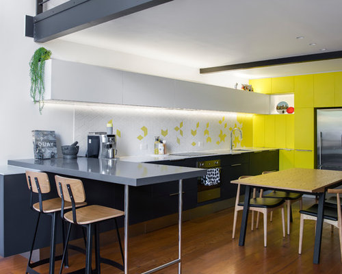 Small Contemporary L Shaped Open Plan Kitchen In Sydney With Flat Panel  Cabinets,