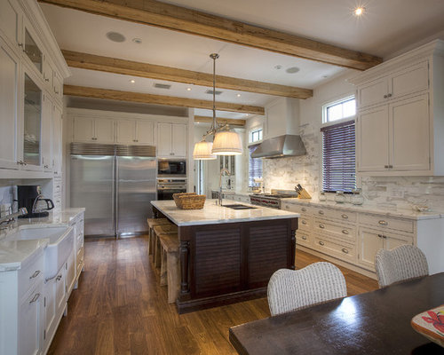 Example Of An Island Style Kitchen Design In Miami With Shaker Cabinets, A  Farmhouse Sink