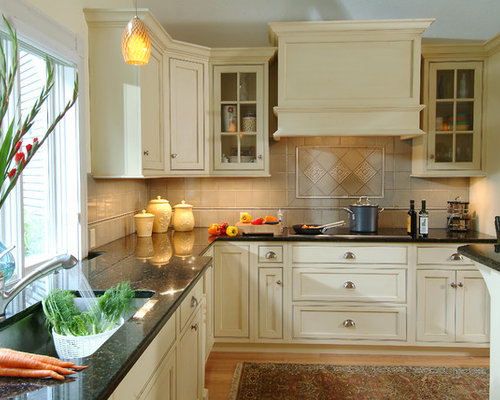 cream kitchen cabinets with black granite countertops black granite with cabinets houzz 14220