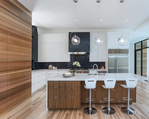Inspiration for a contemporary l-shaped light wood floor and beige floor  open concept kitchen