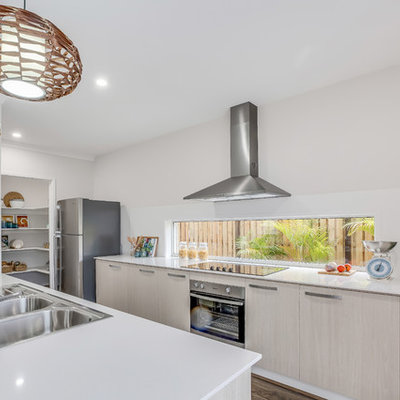 Inspiration for a modern kitchen remodel in Brisbane with a double-bowl sink