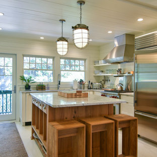 Small coastal eat-in kitchen remodeling - Inspiration for a small coastal l-shaped white floor and painted wood floor eat-in kitchen remodel in Charleston with shaker cabinets, white cabinets, marble countertops, wood backsplash, stainless steel appliances, an island, white backsplash and white countertops