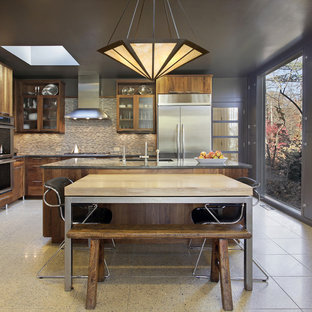 Large transitional eat-in kitchen photos - Inspiration for a large transitional galley limestone floor eat-in kitchen remodel in New York with a drop-in sink, open cabinets, medium tone wood cabinets, marble countertops, multicolored backsplash, ceramic backsplash, stainless steel appliances and an island