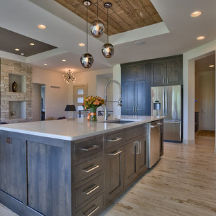 Design ideas for a mid-sized country u-shaped eat-in kitchen in Omaha with a single-bowl sink, recessed-panel cabinets, dark wood cabinets, quartz benchtops, white splashback, ceramic splashback, stainless steel appliances, ceramic floors and with island.