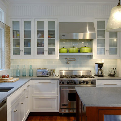 Inspiration for a transitional kitchen remodel in Boston with glass-front cabinets, stainless steel appliances and subway tile backsplash