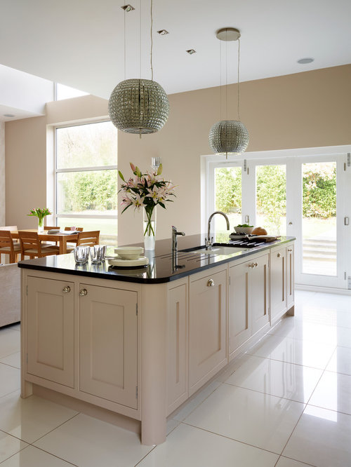 wall open plan kitchen in london with shaker cabinets beige cabinets