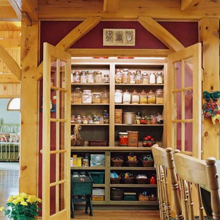 Small rustic l-shaped kitchen pantry in Toronto with open cabinets and medium hardwood flooring.