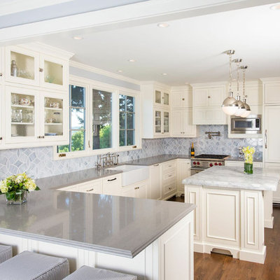 Inspiration for a timeless u-shaped kitchen remodel in Seattle with glass-front cabinets