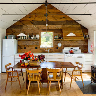 Farmhouse single-wall eat-in kitchen photo in Portland with white appliances, flat-panel cabinets and white cabinets