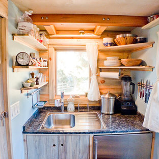 Trendy kitchen photo in San Francisco with a drop-in sink, flat-panel cabinets and stainless steel appliances