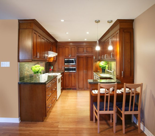 Tropical Kitchen by Wynter Interiors Inc