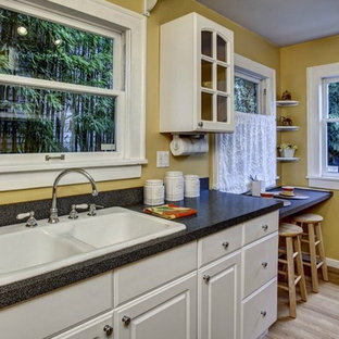 Inspiration for a timeless kitchen remodel in Seattle with a drop-in sink, raised-panel cabinets and white cabinets