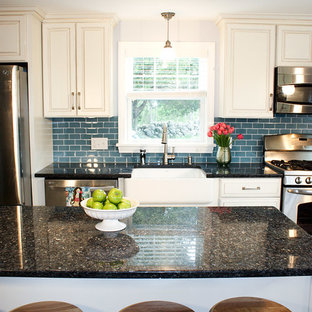 Inspiration for a mid-sized beach style galley eat-in kitchen in Boston with a farmhouse sink, raised-panel cabinets, white cabinets, granite benchtops, blue splashback, subway tile splashback, stainless steel appliances, ceramic floors and with island.