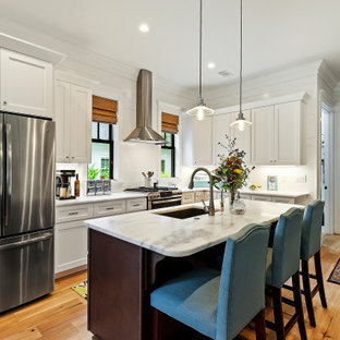 Example of a mid-sized transitional kitchen design in Charleston with an island