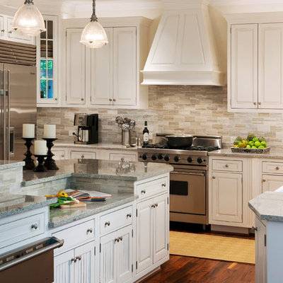 Inspiration for a transitional kitchen remodel in DC Metro with stainless steel appliances, beaded inset cabinets, white cabinets, granite countertops, gray backsplash and travertine backsplash