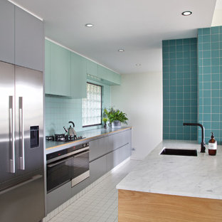 Design ideas for a contemporary galley kitchen in Brisbane with an undermount sink, flat-panel cabinets, blue cabinets, blue splashback, stainless steel appliances and a peninsula.