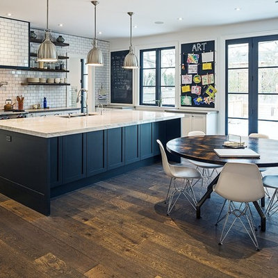 Inspiration for a large transitional dark wood floor eat-in kitchen remodel in Toronto with white backsplash, stainless steel appliances, an island, a double-bowl sink, recessed-panel cabinets, white cabinets, granite countertops and subway tile backsplash