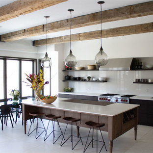 Contemporary single-wall eat-in kitchen in London with a drop-in sink, open cabinets, dark wood cabinets, grey splashback, stone slab splashback and stainless steel appliances.