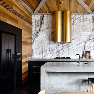 Design ideas for a contemporary eat-in kitchen in Geelong with an integrated sink, flat-panel cabinets, black cabinets, concrete benchtops, black appliances, with island and grey benchtop.