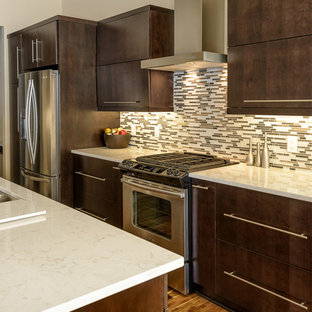 Example of a minimalist kitchen design in Other with quartz countertops