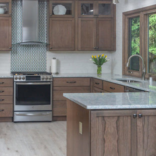 Mid-sized transitional eat-in kitchen pictures - Eat-in kitchen - mid-sized transitional eat-in kitchen idea in Other with recessed-panel cabinets, medium tone wood cabinets, quartz countertops, white backsplash, stainless steel appliances and turquoise countertops