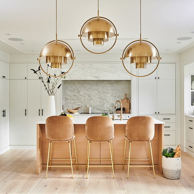Inspiration for a mid-sized contemporary u-shaped medium tone wood floor and beige floor open concept kitchen remodel in Vancouver with an undermount sink, flat-panel cabinets, white cabinets, marble countertops, white backsplash, marble backsplash, paneled appliances, an island and white countertops