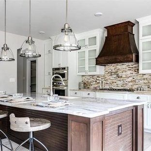 Mid-sized transitional eat-in kitchen ideas - Eat-in kitchen - mid-sized transitional galley light wood floor eat-in kitchen idea in Richmond with shaker cabinets, white cabinets, marble countertops, multicolored backsplash, matchstick tile backsplash, stainless steel appliances, an island and a farmhouse sink