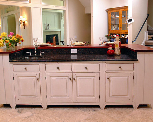 Example Of A Mountain Style Kitchen Design In Cincinnati With Raised Panel  Cabinets And White