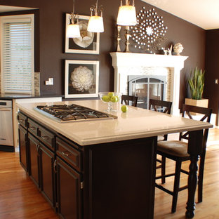 Traditional eat-in kitchen remodeling - Example of a classic eat-in kitchen design in Boise with brown cabinets and quartz countertops