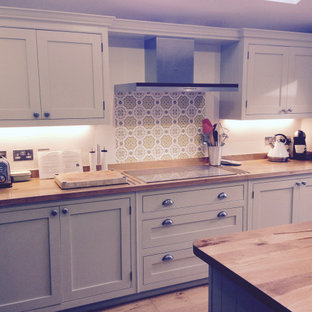Traditional cream, handmade kitchen with wooden worktops and statement tiles
