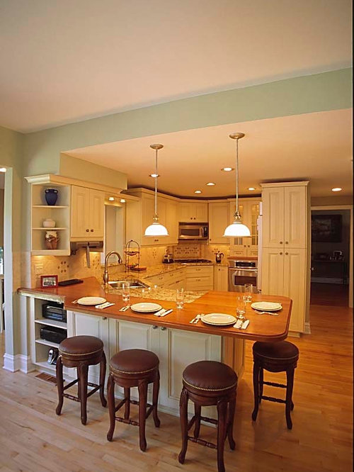 traditional cream kitchen with wood eating counter in glencoe