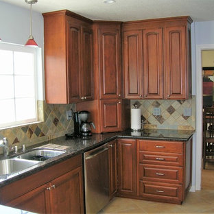 Mid-sized traditional l-shaped open plan kitchen in Los Angeles with an undermount sink, raised-panel cabinets, granite benchtops, multi-coloured splashback, slate splashback, stainless steel appliances, ceramic floors, a peninsula, multi-coloured floor, multi-coloured benchtop and medium wood cabinets.