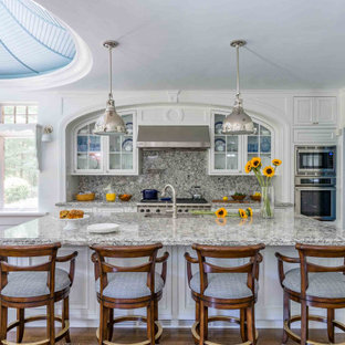Traditional eat-in kitchen designs - Eat-in kitchen - traditional u-shaped eat-in kitchen idea in Boston with raised-panel cabinets, white cabinets and an island