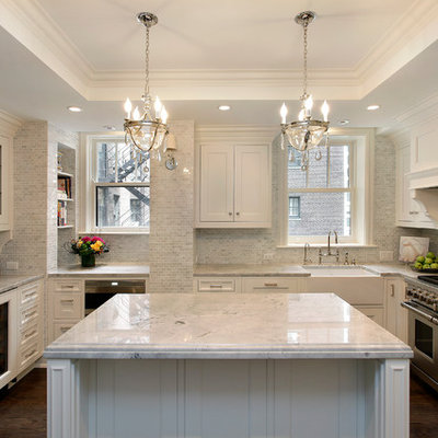 Example of a classic kitchen design in Chicago with glass-front cabinets, a farmhouse sink, quartzite countertops and marble backsplash
