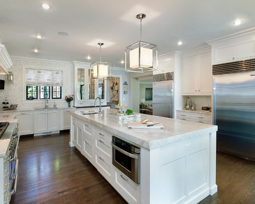 example of a classic ushaped kitchen design in other with stainless steel appliances