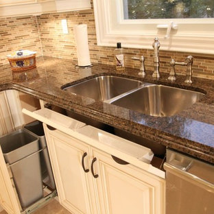 Photo of a mid-sized traditional u-shaped eat-in kitchen in Toronto with a double-bowl sink, quartz benchtops, brown splashback, ceramic splashback, stainless steel appliances, porcelain floors, no island, yellow floor, white cabinets and raised-panel cabinets.