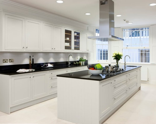 Mid Sized Elegant Enclosed Kitchen Photo In London With Shaker Cabinets White