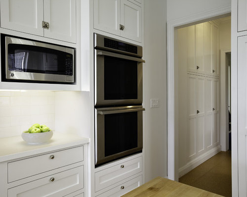 example of a large classic lshaped light wood floor eatin kitchen design