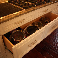 traditional kitchen cabinets by Architectural Justice