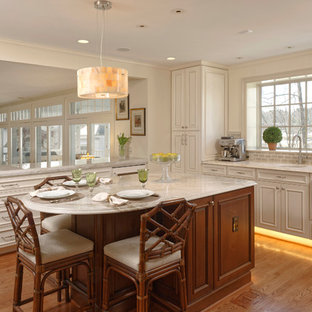Inspiration for a timeless medium tone wood floor open concept kitchen remodel in DC Metro with a single-bowl sink, recessed-panel cabinets, white cabinets, gray backsplash, subway tile backsplash and stainless steel appliances