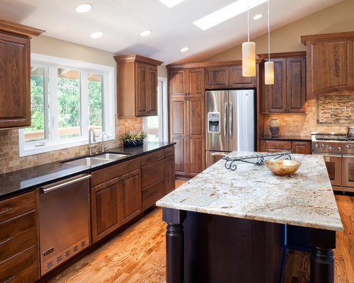 Traditional cherry cabinets dark countertop kitchen design for Traditional dark kitchen cabinets