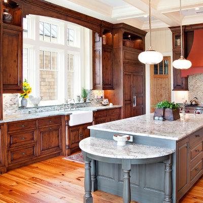 Kitchen - traditional l-shaped kitchen idea in Charleston with paneled appliances, a farmhouse sink, raised-panel cabinets, dark wood cabinets, multicolored backsplash and mosaic tile backsplash