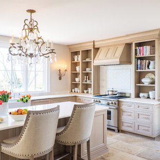 Mid-sized traditional kitchen ideas - Kitchen - mid-sized traditional beige floor and limestone floor kitchen idea in Boston with a farmhouse sink, open cabinets, light wood cabinets, white backsplash, stainless steel appliances, an island, marble countertops and marble backsplash