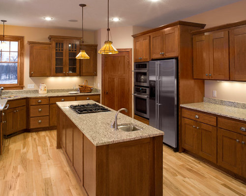 inspiration for a timeless kitchen remodel in minneapolis with shaker cabinets medium tone wood cabinets - Kitchen Design Ideas With Oak Cabinets
