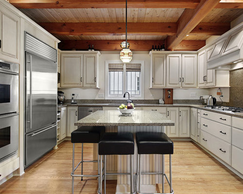 Example Of A Classic Kitchen Design In Minneapolis With Stainless Steel Appliances