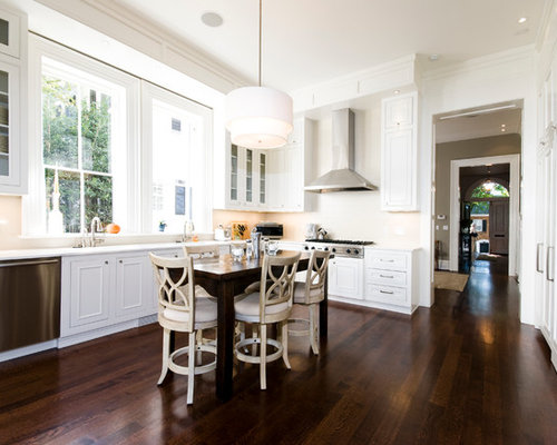 Example of a classic kitchen design in DC Metro with glass-front ...
