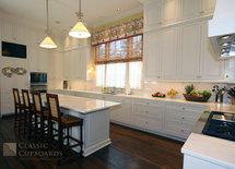 What is the backsplash tile and what is the wood on the floo?  Beautiful kitchen